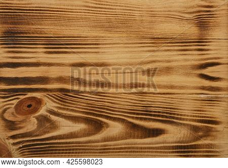 Close Up Background Texture Of Vintage Weathered Burnt And Brushed Pine Wood Surface With Knots And