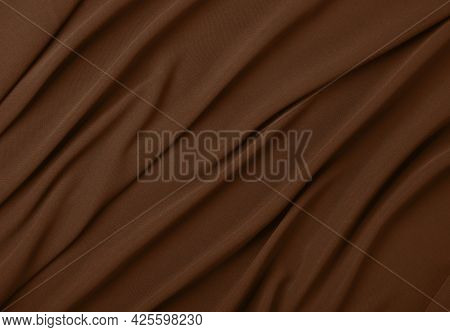 Close Up Abstract Textile Background Of Dark Brown Folded Pleats Of Fabric, Elevated Top View, Direc