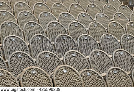 Rows Of Empty Grey Brown Wicker Seats In Open Air Concert Hall Auditorium, Low Angle Side View