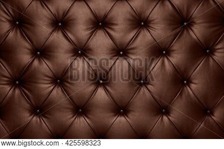 Close Up Background Texture Of Dark Brown Capitone Genuine Leather, Retro Chesterfield Style Soft Tu