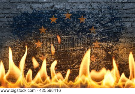 Close Up Wall With Painted European Union Eu Flag In Flames As Symbol Of World On Fire, Danger, Poli