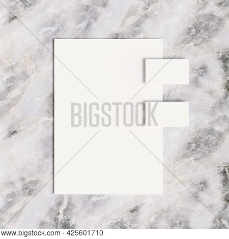 Business Cards And Office Paper On Marble Surface. 3d Illustraton.