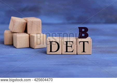 Wooden Blocks With The Word Debt. Reduction Or Restructuring Of Debt. Refusal To Pay Debts Or Loans
