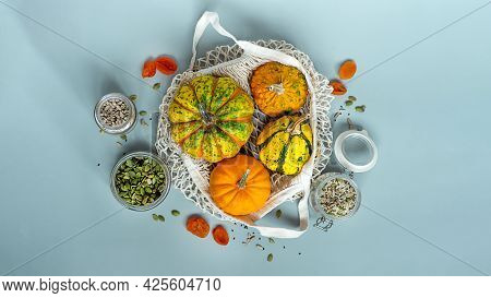 Zero Waste Healthy Food Pumpkin, Seeds, Vegetables, Dried Fruits Flat Lay On Blue Background. Grocer