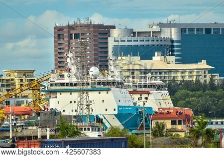 Labuan,malaysia-may 22,2021:offshore Supply Vessels At Rancha Rancha Industrial Estate With Backgrou