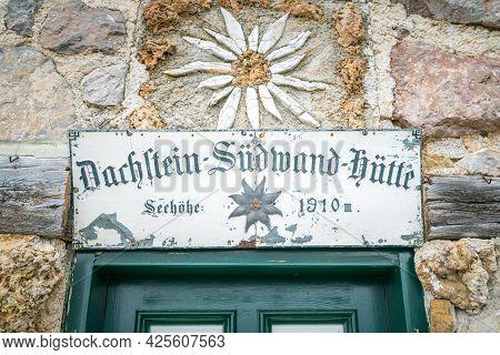 Dachstein, Austria - 09.23.2018: Sign Above The Green Door Of Sudwand Hutte In The Hoher Dachstein A