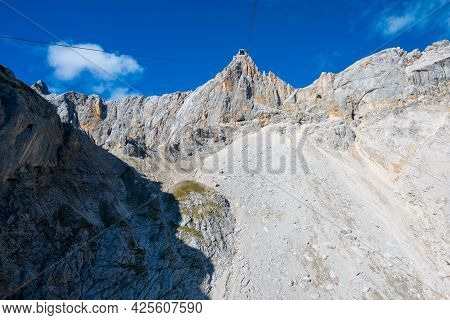 Low Angle Shot Of Cable Way Up To Hunerkogel In Austrian Alps, Right Next To Schladming Glacier And