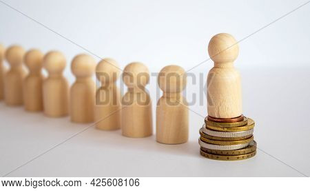 Wooden Blocks Of People Silhouettes. Money Concept