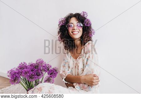 Glad African Girl With Beautiful Smile Posing On White Background With Flowers. Joyful Black Young L