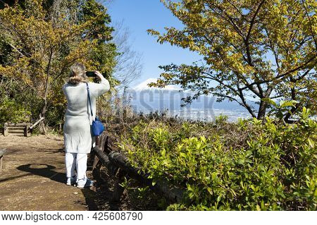 Woman Taking A Photo Of Mount Fuji, With Aerial View Of Fuji City On A Beautiful Winter Morning. Pho