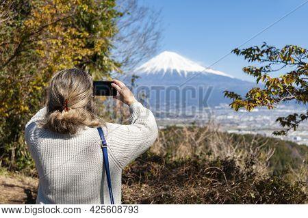 Woman Taking A Photo Of Mount Fuji, With An Aerial View Of Fuji City. Photo Taken From Noroshiba, Ka