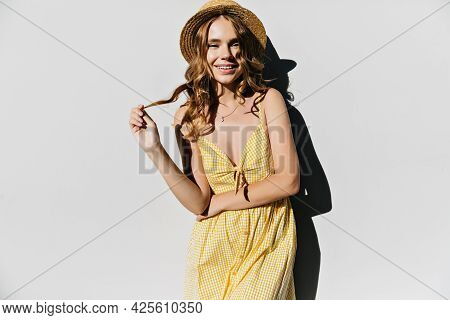 Good-humoured White Lady Touching Her Hair With Gently Smile. Studio Shot Of Sensual Caucasian Woman
