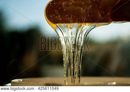 Shugaring Paste. Body Hair Removal. Depilation. The Paste Drips Off The Sugaring Spatula. Body Care