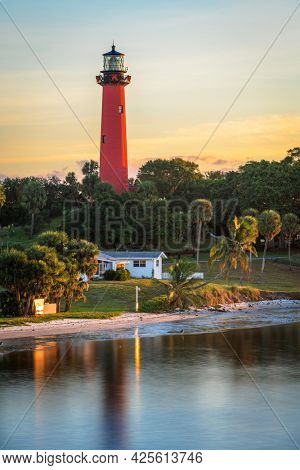 Jupiter, Florida, USA and inlet lighthouse at dawn.