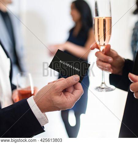 Businessman handing over a business card mockup