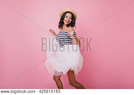 Beautiful Slim Girl Funny Dancing And Smiling. Good-humoured Female Model In White Lush Skirt Expres