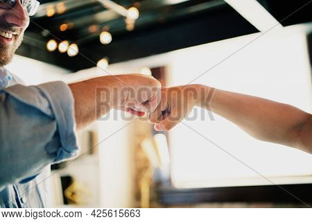 Colleagues doing a fist bump