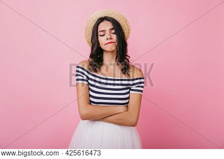 Unhappy Tanned Woman In Trendy Clothes Posing With Eyes Closed. Studio Shot Of Good-looking Lady Wit