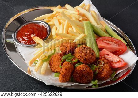 Chicken Breast Nuggets With Popular Sauce And Chips And Vegetables For Choice On Silver Tray