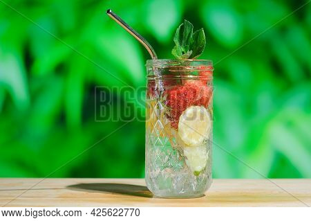 Summer Cocktails, Refreshing Drinks Concept. Drinking Glass Of Hard Seltzer Cocktail With Strawberry