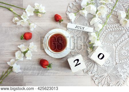 Calendar For July 20 : Cubes With The Number 20, The Name Of The Month Of July In English, A Cup Of