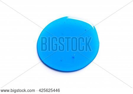 Blue Shampoo Or Shower Gel Texture Isolated On White Background. Blue Gel Cosmetic Product Drop.