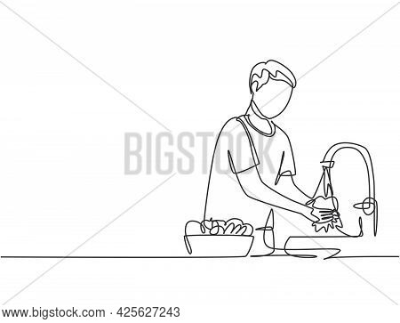 Single Continuous Line Drawing A Man Washes Fruits In The Sink From The Germs That Stick To Clean. C