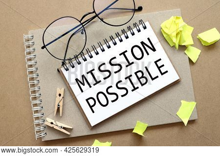 Mission Possible. Text On White Paper On Notepad. On Craft Background