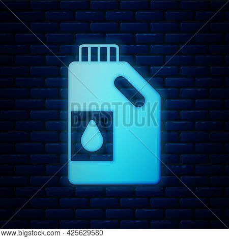 Glowing Neon Canister For Motor Machine Oil Icon Isolated On Brick Wall Background. Oil Gallon. Oil