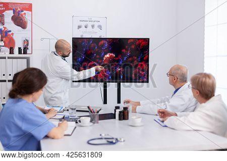 Virolog Man Specialist Talking About Coronavirus Symptoms During Virus Presentation In Front Of Prac