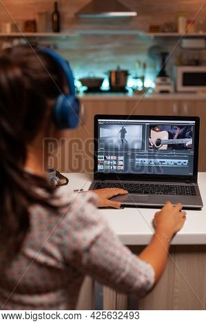 Filmmaker Editing Video Footage In Home Using Modern Technology. Content Creator In Home Working On
