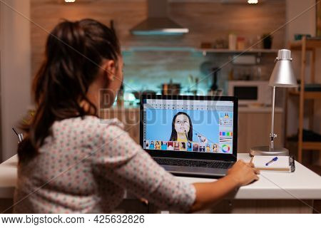Professional Graphic Editor Retouching Photos Of A Client During Night Time In Home Office. Photogra