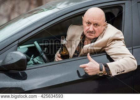 Drunk And Crazy Senior In Automobile. Mature Older Man Lifestyle