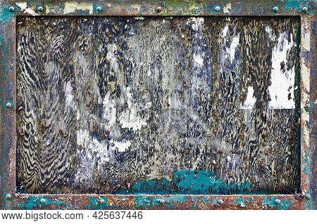 A Heavily Weathered And Textured Noticeboard. The Image Can Also Be Used As A Background Or Texture.