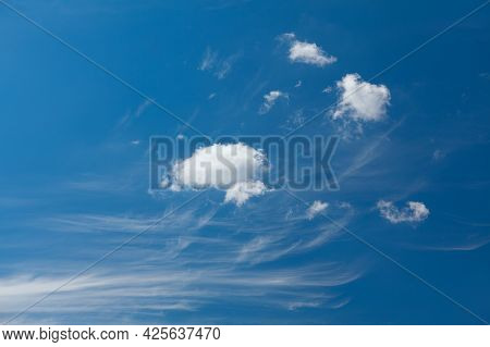 Generic White Clouds On The Blue Sky . Summer Daytime Clouds