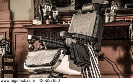 Stylish Vintage Barber Chair. Professional Hairstylist In Barbershop Interior. Barber Shop Chair