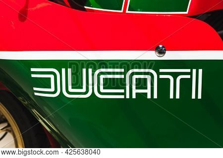St.petersburg, Russia - April 3, 2019: Ducati Brand Name Logo Is On A Red Green Sports Sports Bike H