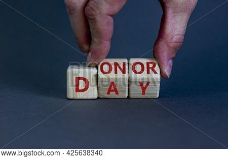 Donor Day Symbol. Doctor Turns Wooden Cubes With Words 'donor Day'. Beautiful Grey Background. Donor