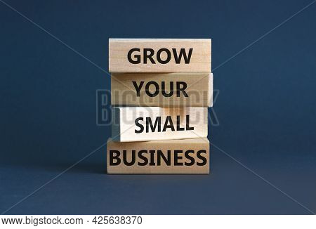 Grow Your Small Business Symbol. Concept Words 'grow Your Small Business' On Wooden Blocks On A Beau