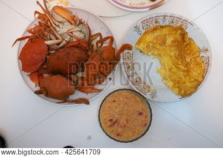 Boiled Fresh Crabs And Thai Omelet Served With Seafood Spicy Sauce. The Concept Of Homemade Food