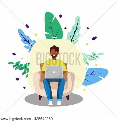 Man Working From Home On Lap Top. Dark Skin Man Sitting On Armchair. Freelance, Remote Working, Home