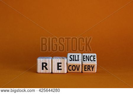 Recovery And Resilience Symbol. Turned Wooden Cubes And Changed The Word 'recovery' To 'resilience'.