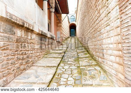 Corridor In Old Brick Castle With Passage And Gate
