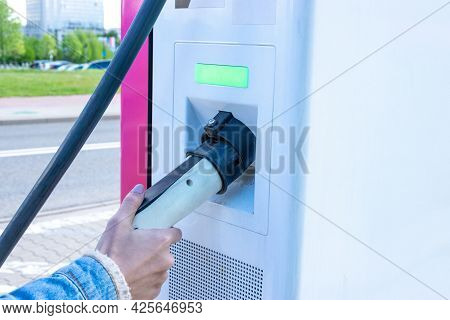 Electric Car Charge. Power Cable Pump Plug In Eco Green Energy Hybrid Vehicle On Future Charger Stat