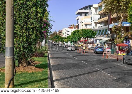 Alanya, Turkey - October 23, 2020: Paved Road With Transport On Ataturk Boulevard In Alanya. Beautif