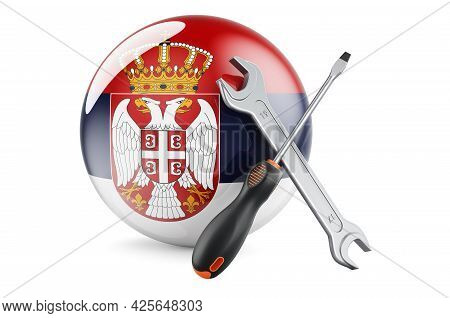 Service And Repair In Serbia Concept. Screwdriver And Wrench With Serbian Flag, 3d Rendering Isolate