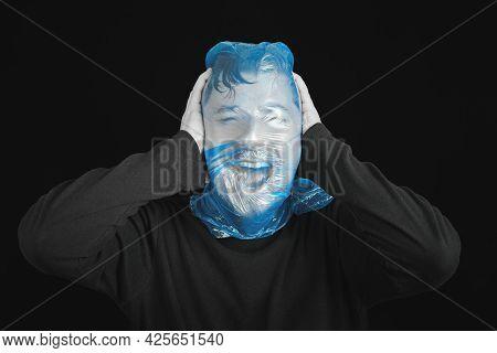 Blue Garbage Bag On Man Head. Exit Bag For Suicide. Self-asphyxiation Concept. Suicide Bag On Man He