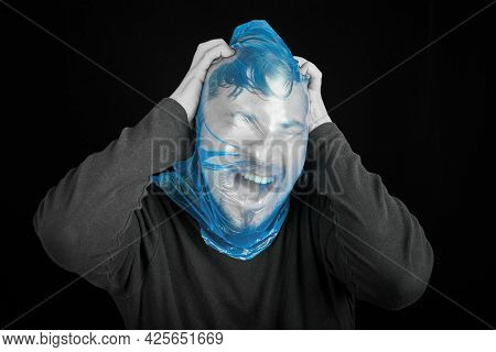 Suicide Bag On Man Head. Exit Bag For Suicide. Self-asphyxiation Concept. Garbage Bag On Head. Short