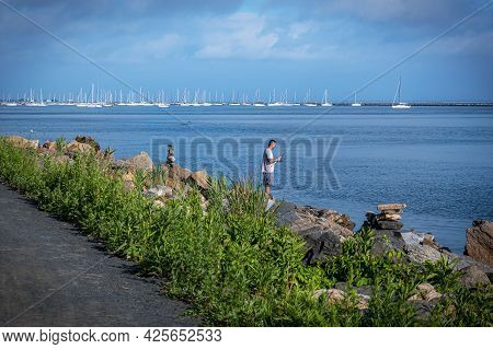 Atlantic Highlands, New Jersey - June 27: A Man Fishing On Sandy Hook Bay On June 27 2021 In Atlanti