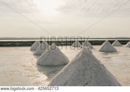 Close Up Of Salt Piles In Salt Farm Made From Sea Water In Thailand.